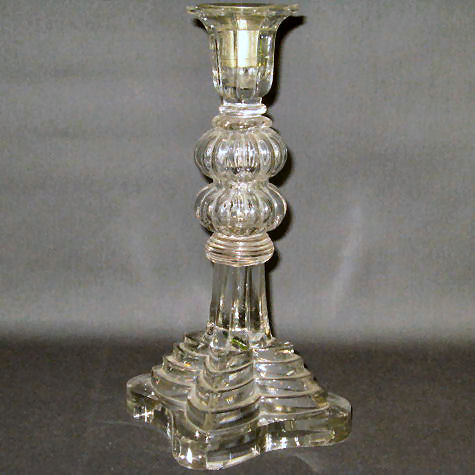 This one has a double melon knop center stem and a five tier pressed base