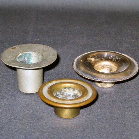 Candlestick Inserts used for when the candle burns down too far, the heat would not damage the glass.  These are found made of various materials but the earliest are pewter as the one pictured on left.